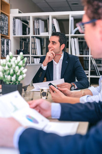 Businessman thinking in a meeting with teamwork