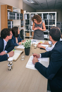 Businesswoman talking in a meeting to teamwork