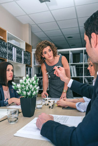 Businesswoman talking with colleague in a meeting