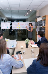 Female coach training business team at headquarters