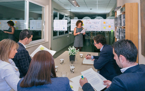 Female coach looking project management in business team training