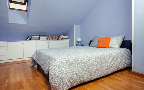 Bedroom in an attic with double bed