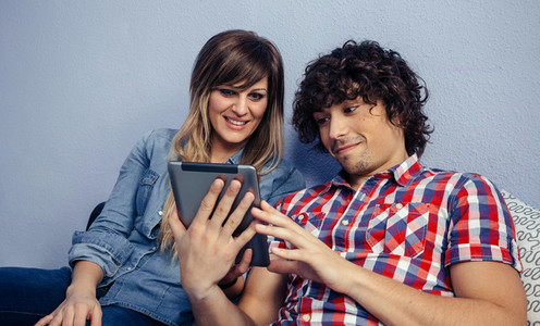 Couple looking at the tablet
