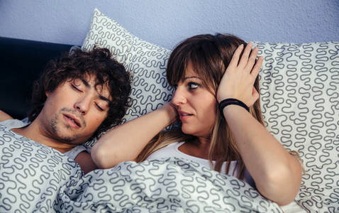 Man snoring and his wife annoyed