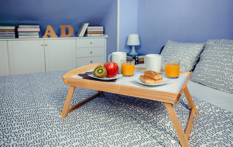 Bed tray with breakfast for two on bed