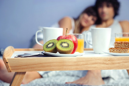 Pieces of fruit in healthy breakfast served on tray