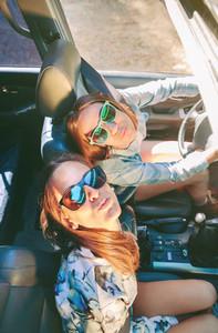 Happy women having fun inside of cabriolet car