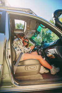 Woman showing photo to her friend inside of car