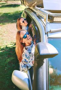 Happy women having fun through the window car