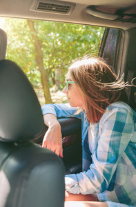 Young woman looking landscape through the window car