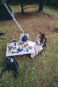 Young women having breakfast in a campsite
