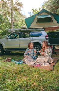 Women sitting under blanket with 4x4 on background