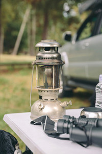 Close up of oil lamp over camping table