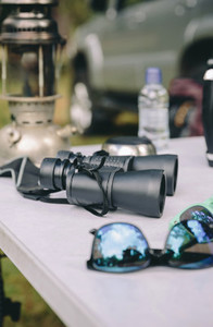 Close up of binoculars over camping table