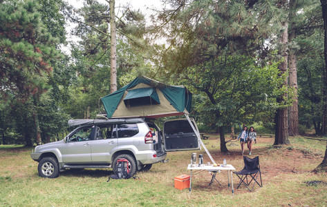 Camping table and off road vehicle in campsite