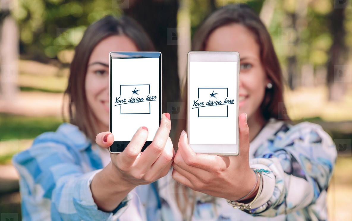 Women showing smartphones with their selfie photos