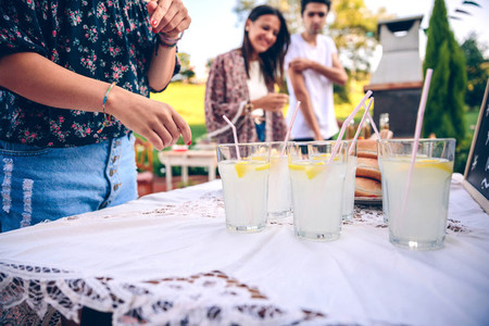 Friends at table with fresh lemonade having fun