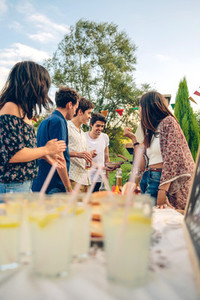 Group of friends having fun in a summer barbecue