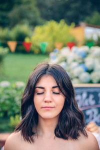Portrait of woman with closed eyes in garden