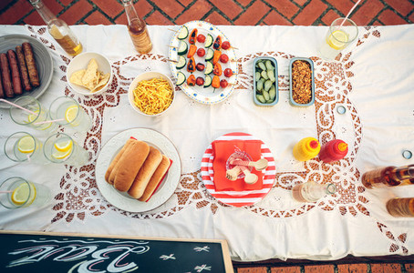 Table with food and drinks in summer party