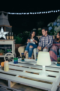 White lamp over pallets table in outdoors party