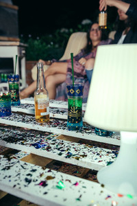 Beverages over pallets table with confetti in outdoors party