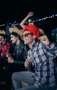 Happy man with wig having fun in party