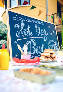 Blackboard over table with food and drinks in party