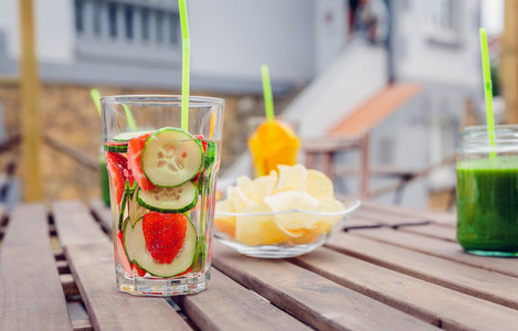 Infused fruit water cocktails and green vegetable smoothies