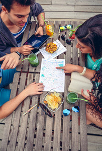 Young friends looking map over a table