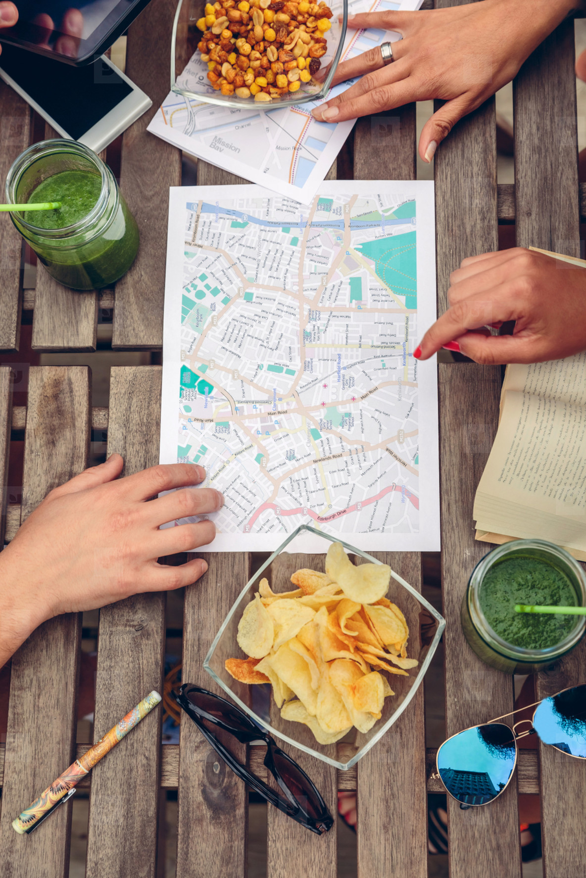 People hands over map on a table