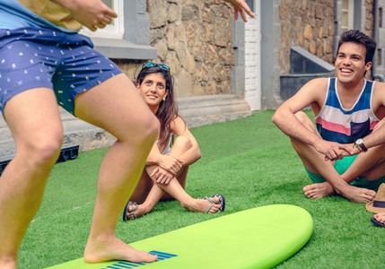 Young couple having fun in a surf class