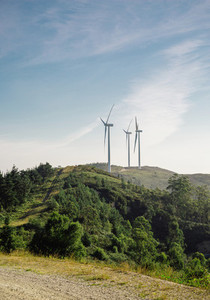 Mountain landscape with wind turbines in the background