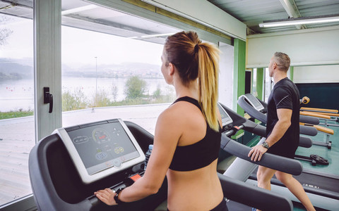People warming up over treadmill in training session