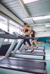 People running over treadmill in a training session