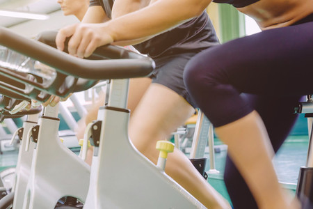 People legs in motion during a bike training