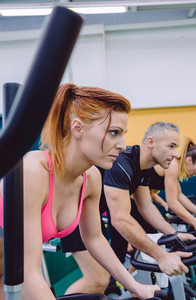 Woman concentrated in a hard bike training session