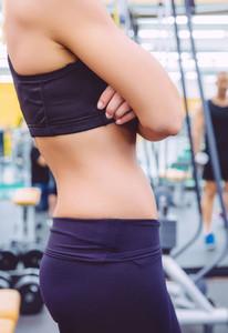 Slim waist closeup of sporty woman with black sportswear