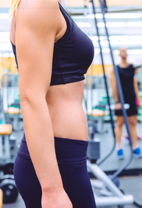 Slim waist closeup of sporty woman with black sportswear