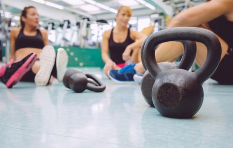 Black iron kettlebell on the floor of fitness center
