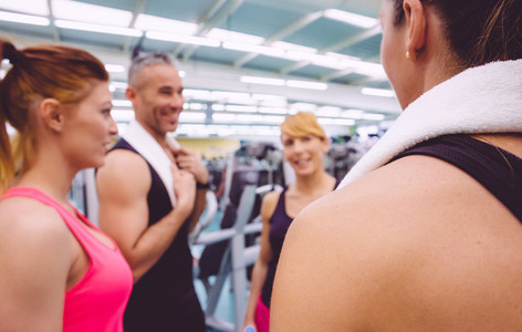 Women talking with personal trainer after training day