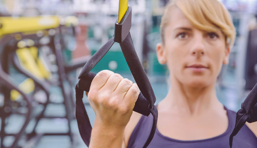 Fitness strap in the hand of woman training