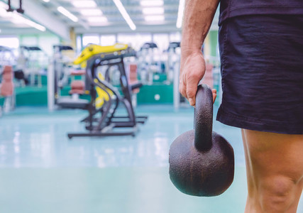 Man holding kettlebell in a crossfit training