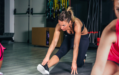 Woman stretching legs in a fitness class