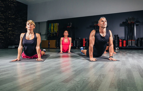 People stretching back in a fitness class