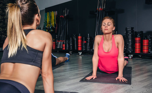 Woman stretching back in a fitness class
