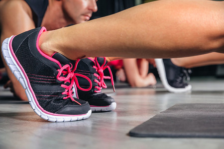 Woman legs with sneakers doing fitness exercises