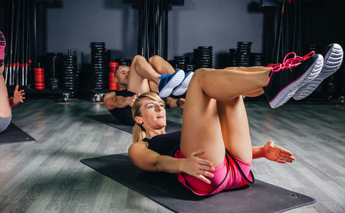 People doing abs in a fitness class