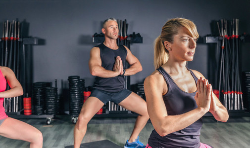 Woman doing stretch exercises in fitness class
