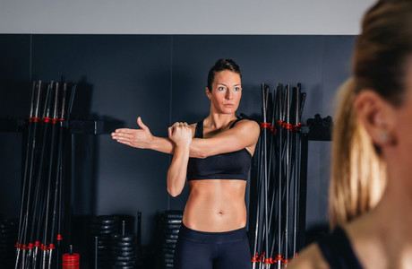 Woman stretching her arms in fitness class